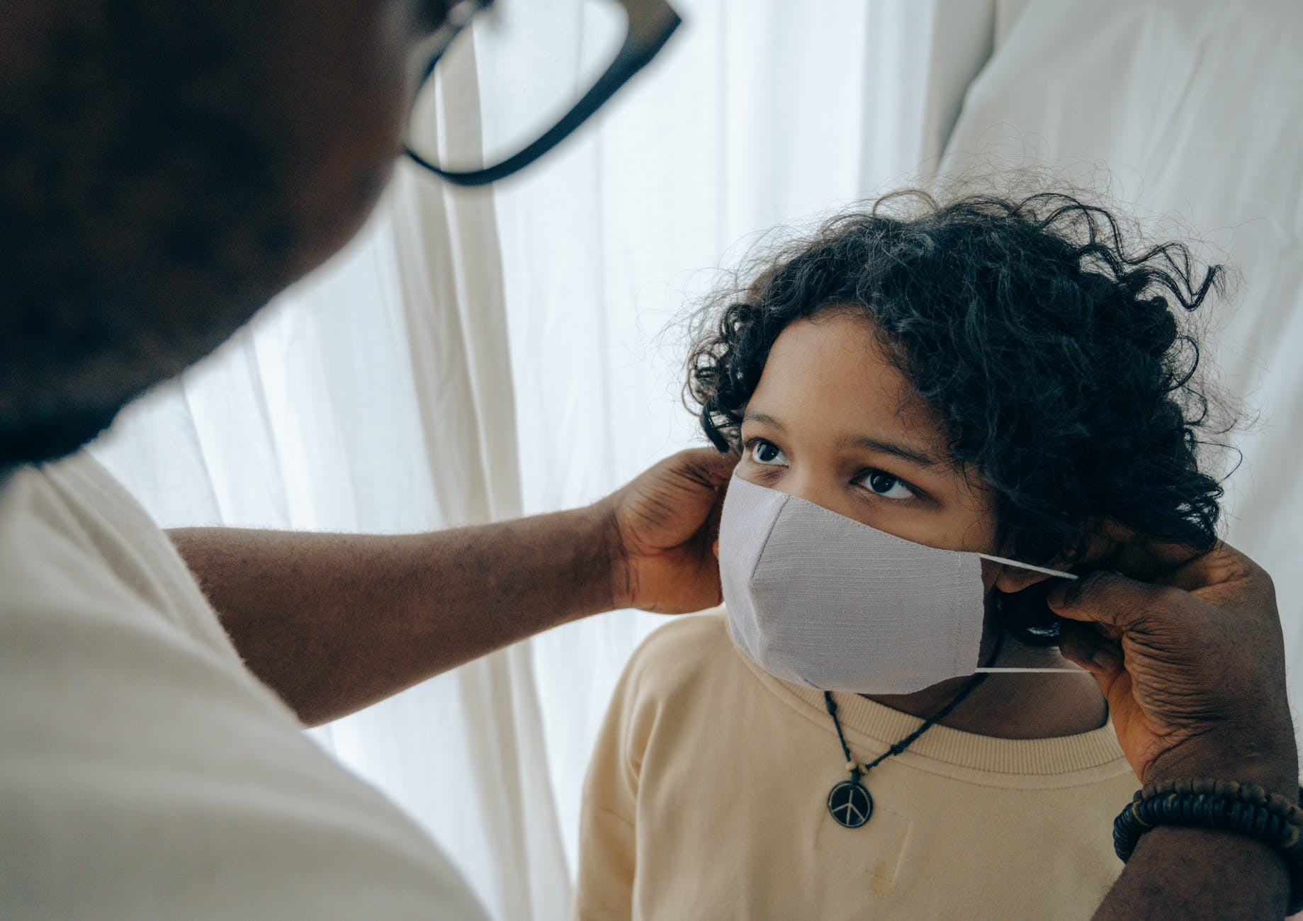 child wearing facemask for pediatric dentist blog